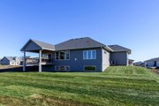 Ranch Style House Plan - 4 Beds 3 Baths 1703 Sq/Ft Plan #70-1500 Exterior - Rear Elevation