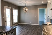 Cottage Style House Plan - 3 Beds 2 Baths 1782 Sq/Ft Plan #406-9657 Interior - Dining Room