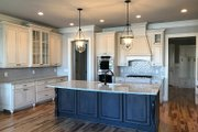 Country Style House Plan - 4 Beds 4.5 Baths 4371 Sq/Ft Plan #437-81 Interior - Kitchen