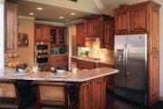 Country Style House Plan - 3 Beds 2.5 Baths 2400 Sq/Ft Plan #927-287 Interior - Kitchen