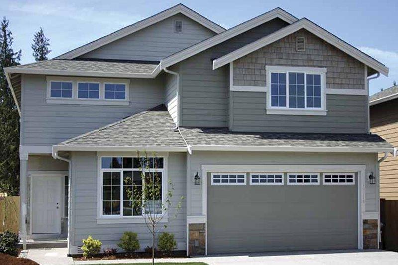 Contemporary Exterior - Front Elevation Plan #951-11 - Houseplans.com