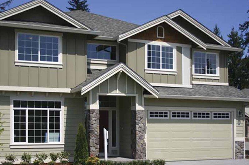 Contemporary Exterior - Front Elevation Plan #951-22 - Houseplans.com