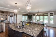 Country Style House Plan - 4 Beds 3 Baths 2578 Sq/Ft Plan #929-969 Interior - Kitchen