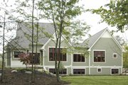 Bungalow Style House Plan - 2 Beds 2.5 Baths 2243 Sq/Ft Plan #928-169 Exterior - Rear Elevation