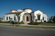 Mediterranean Style House Plan - 4 Beds 3.5 Baths 4697 Sq/Ft Plan #1058-10 Exterior - Front Elevation