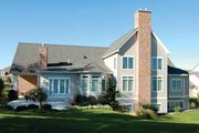 Traditional Style House Plan - 3 Beds 3.5 Baths 3604 Sq/Ft Plan #928-222 Exterior - Rear Elevation