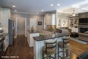 Country Style House Plan - 4 Beds 3 Baths 2304 Sq/Ft Plan #929-610 Interior - Kitchen