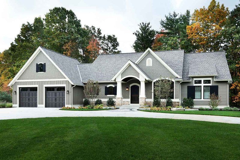 Craftsman Style House Plan - 3 Beds 3.5 Baths 4135 Sq/Ft Plan #928-318 Exterior - Front Elevation