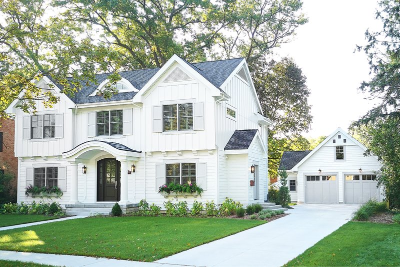 Traditional Style House Plan - 5 Beds 3.5 Baths 4834 Sq/Ft Plan #928-349 Exterior - Front Elevation