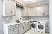 European Style House Plan - 5 Beds 5 Baths 4357 Sq/Ft Plan #929-893 Interior - Laundry