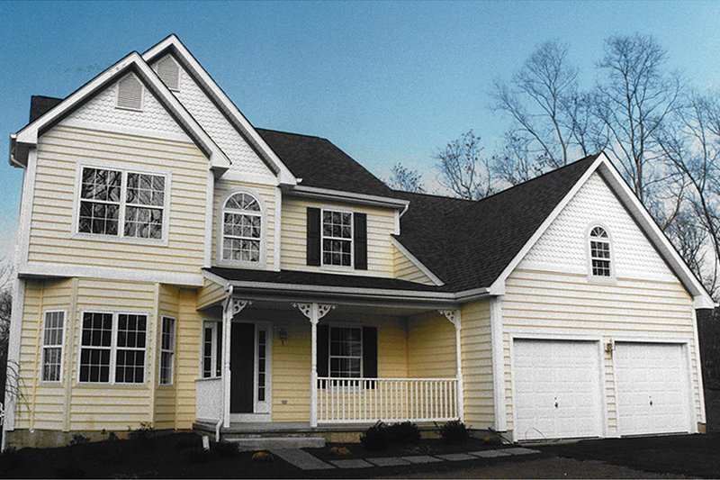 Country Exterior - Front Elevation Plan #1053-60 - Houseplans.com