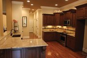 Country Style House Plan - 3 Beds 2.5 Baths 2170 Sq/Ft Plan #927-150 Interior - Kitchen