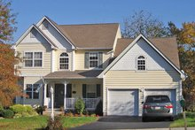 House Plan Design - Country Exterior - Front Elevation Plan #1053-60