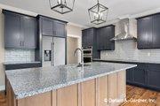 Cottage Style House Plan - 4 Beds 3 Baths 2458 Sq/Ft Plan #929-1108 Interior - Kitchen