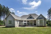 Country Style House Plan - 4 Beds 3 Baths 2304 Sq/Ft Plan #929-610 Exterior - Rear Elevation