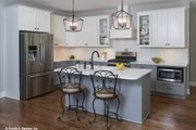 Farmhouse Style House Plan - 3 Beds 2 Baths 1645 Sq/Ft Plan #929-1044 Interior - Kitchen