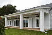 Colonial Style House Plan - 3 Beds 3 Baths 2562 Sq/Ft Plan #1058-148 Exterior - Rear Elevation