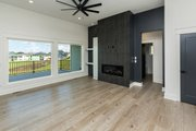 Ranch Style House Plan - 3 Beds 2 Baths 1837 Sq/Ft Plan #70-1477 Interior - Family Room