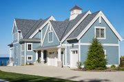 Country Style House Plan - 2 Beds 2.5 Baths 2557 Sq/Ft Plan #928-297 Exterior - Front Elevation