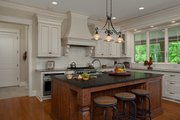 Country Style House Plan - 4 Beds 4.5 Baths 5008 Sq/Ft Plan #928-265 Interior - Kitchen