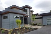 Modern Style House Plan - 4 Beds 4 Baths 3712 Sq/Ft Plan #892-17 Exterior - Front Elevation