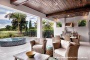 Mediterranean Style House Plan - 3 Beds 3 Baths 3648 Sq/Ft Plan #930-449 Exterior - Rear Elevation