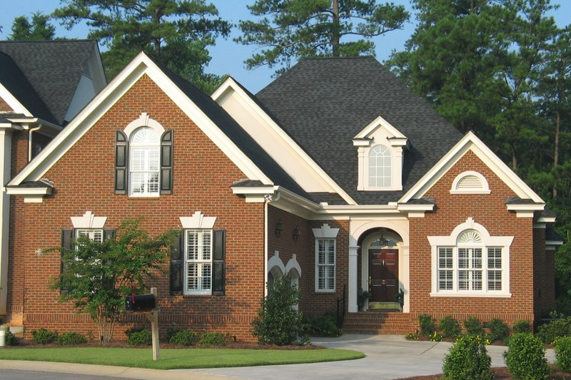 House Plan Design - Traditional Exterior - Front Elevation Plan #1054-77