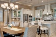 Mediterranean Style House Plan - 3 Beds 3 Baths 3648 Sq/Ft Plan #930-449 Interior - Dining Room