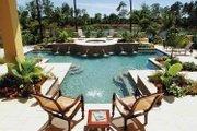 Mediterranean Style House Plan - 3 Beds 4.5 Baths 5199 Sq/Ft Plan #930-314 Exterior - Rear Elevation