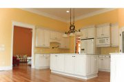Country Style House Plan - 3 Beds 2.5 Baths 2395 Sq/Ft Plan #927-129 Interior - Kitchen