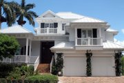 Beach Style House Plan - 4 Beds 5.5 Baths 5796 Sq/Ft Plan #27-474 Exterior - Front Elevation