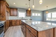 Ranch Style House Plan - 2 Beds 2 Baths 1736 Sq/Ft Plan #70-1484 Interior - Kitchen
