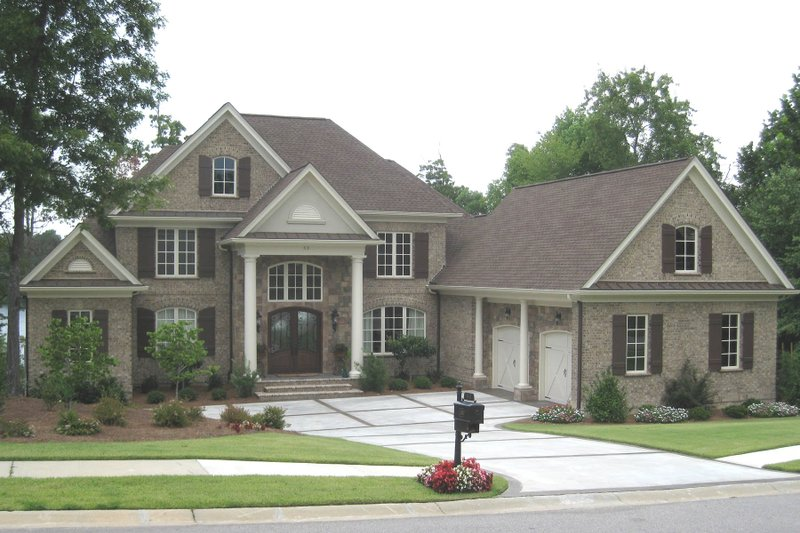 Traditional Style House Plan - 4 Beds 3.5 Baths 3771 Sq/Ft Plan #1054-24 Exterior - Front Elevation