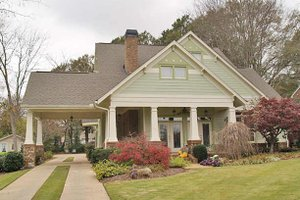 1600 square foot craftsman home with large front porch and outdoor living and entertaining spaces.