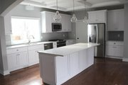 Traditional Style House Plan - 3 Beds 2.5 Baths 2674 Sq/Ft Plan #1057-13 Interior - Kitchen