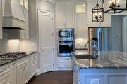 Craftsman Style House Plan - 3 Beds 2.5 Baths 2136 Sq/Ft Plan #437-113 Interior - Kitchen