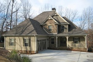 Craftsman style home in the woods photo elevation