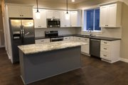 Craftsman Style House Plan - 3 Beds 2 Baths 1522 Sq/Ft Plan #1070-46 Interior - Kitchen