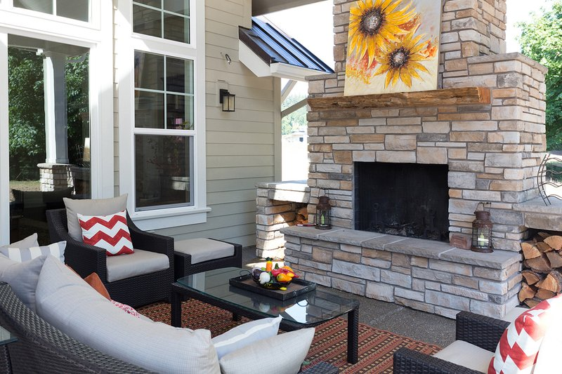Craftsman style home, covered patio with Fireplace photo