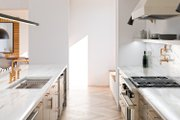 Modern Style House Plan - 3 Beds 2.5 Baths 2316 Sq/Ft Plan #1076-1 Interior - Kitchen