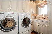 Prairie Style House Plan - 4 Beds 4.5 Baths 3716 Sq/Ft Plan #80-198 Interior - Laundry