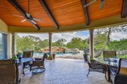 Mediterranean Style House Plan - 4 Beds 5 Baths 4320 Sq/Ft Plan #80-199 Exterior - Covered Porch