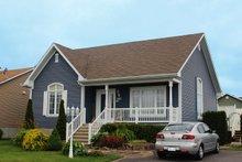Cottage Exterior - Front Elevation Plan #23-609