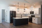 Craftsman Style House Plan - 3 Beds 2 Baths 1841 Sq/Ft Plan #1070-25 Interior - Kitchen