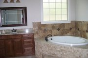 Traditional Style House Plan - 4 Beds 3 Baths 2899 Sq/Ft Plan #927-6 Interior - Master Bathroom