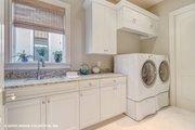 Mediterranean Style House Plan - 3 Beds 3.5 Baths 3700 Sq/Ft Plan #930-511 Interior - Laundry
