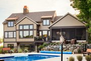 Craftsman Style House Plan - 4 Beds 3.5 Baths 4129 Sq/Ft Plan #928-260 Exterior - Rear Elevation