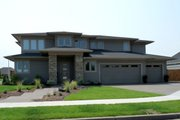 Prairie Style House Plan - 4 Beds 3 Baths 3109 Sq/Ft Plan #124-969 Exterior - Front Elevation