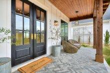 Architectural House Design - Farmhouse Exterior - Covered Porch Plan #430-156