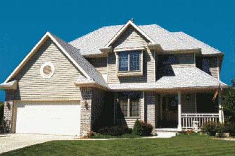 Traditional Exterior - Front Elevation Plan #20-705 - Houseplans.com